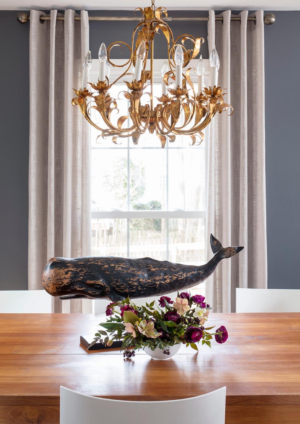 gold vintage chandelier, gray walls, teak dining table