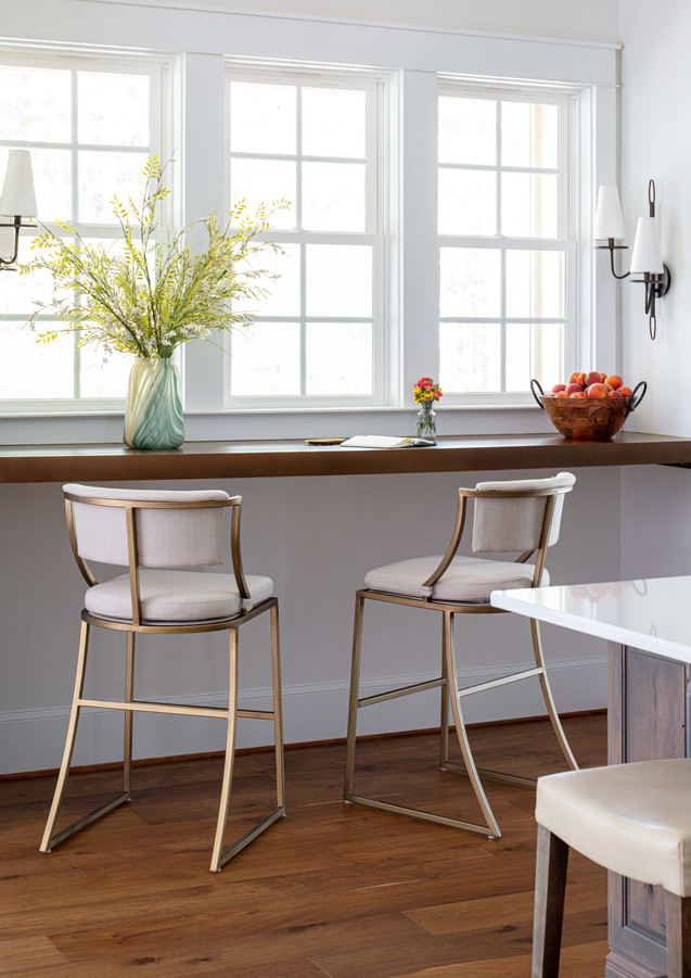A custom breakfast bar takes advantage of the existing nook.
