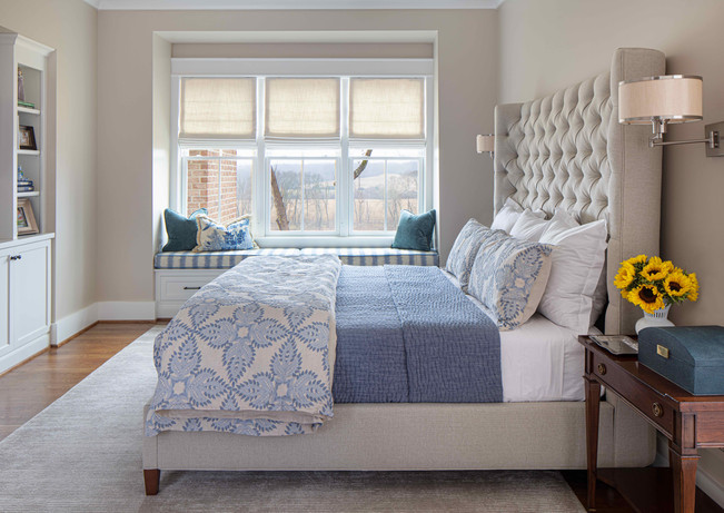 The main bedroom is a study in classic patterns and tranquil colors. The view beyond further promotes restful relaxation.
