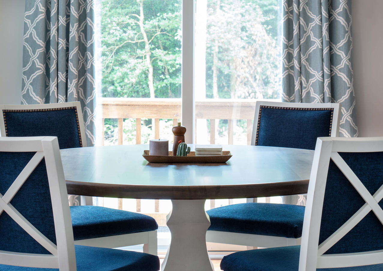 Many textures come together harmoniously just off the kitchen in this lovely, but sturdy, dining area.