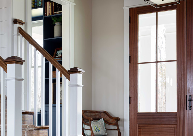 A small entry lives large with oversized lighting and views to rooms beyond.