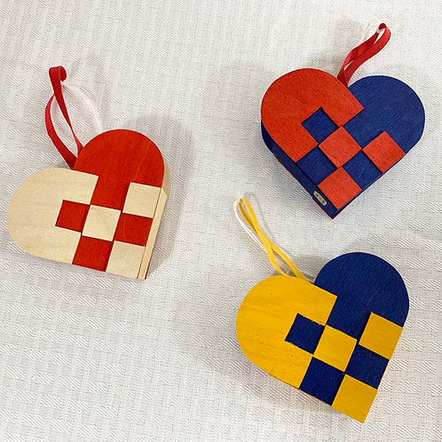 An Assorted Pair of Wood Heart Ornaments
