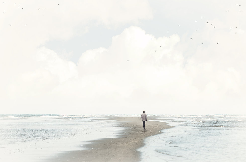 calm man walking in the sand between two