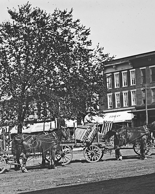 historic horse and buggies picture on downtown square