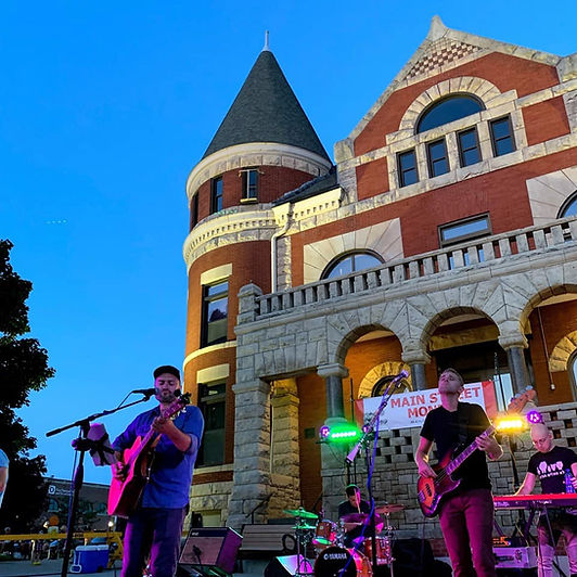 outdoor concert in front of gothic courthouse