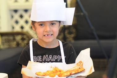 Sophia with Pizza.JPG