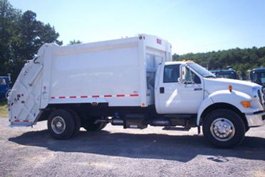 2011 Ford F750 Heil 20yd Rear Loader