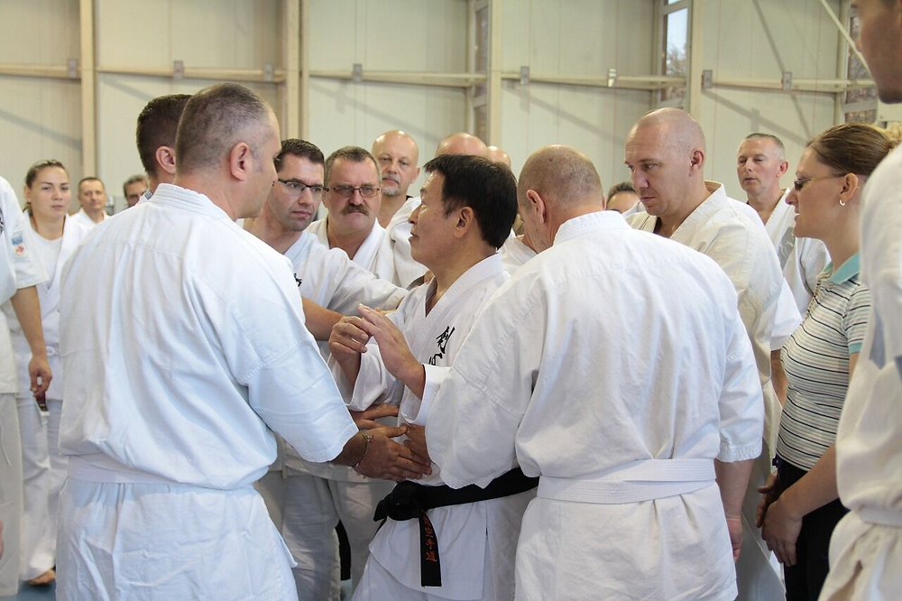 Ushiro Sensei inviting attendees to touch his body and feel the difference between bujutsu and sports
