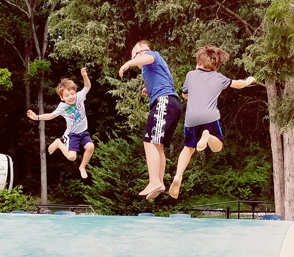 Reece and his cousins on the jumping pillow