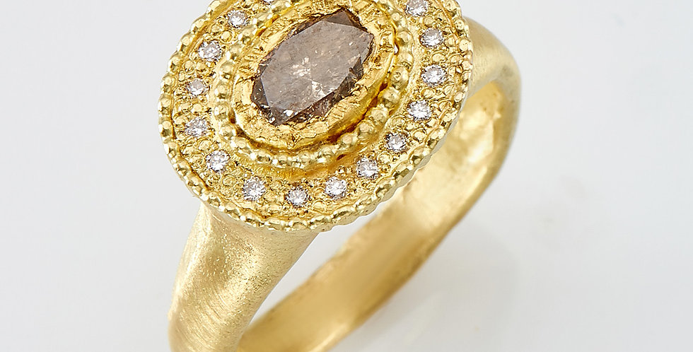 Brownish central diamond with white diamonds ring
