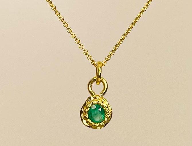 Tiny round Emerald pendant