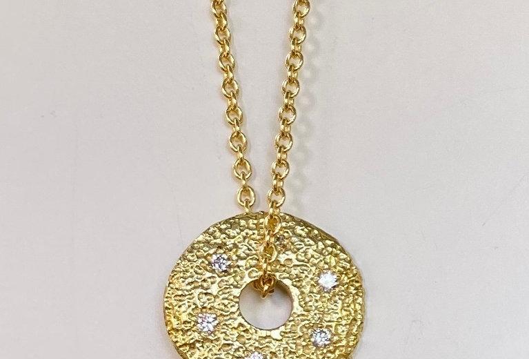 Round textured disc with diamonds
