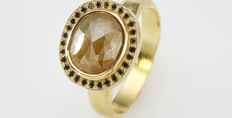 Oval Olive color rough diamond with black diamonds