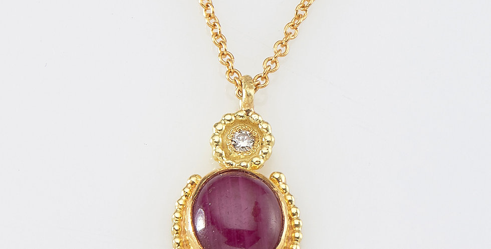 Oval Ruby pendant with small diamond