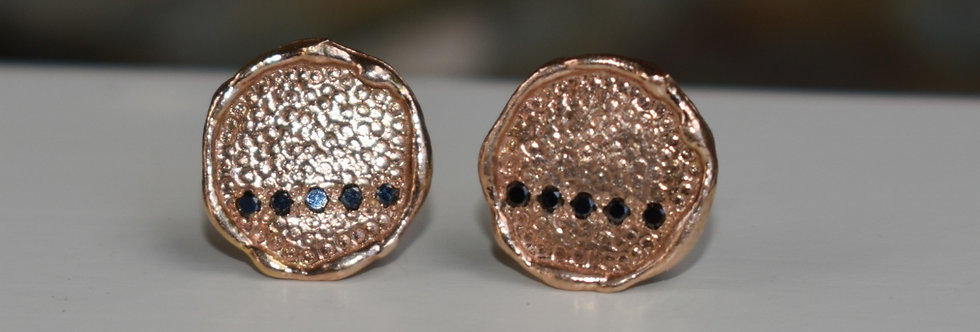 Rose gold studs with black diamonds