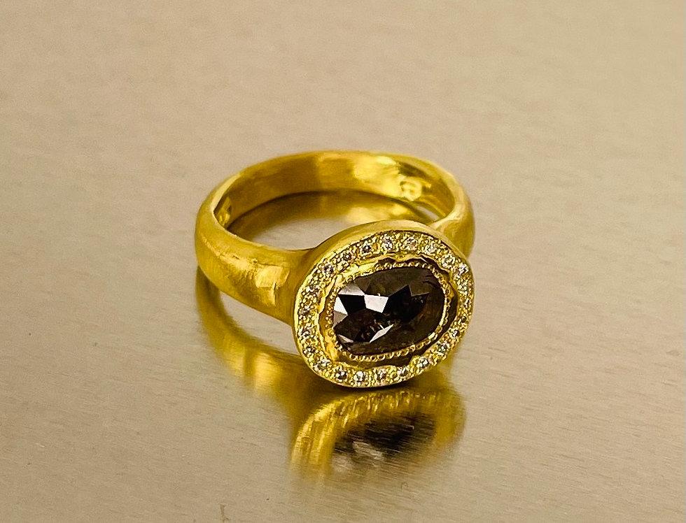Black brown rough diamond with white diamonds around