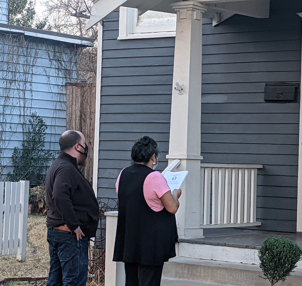 Tenant reading demands at the landlords doorstep