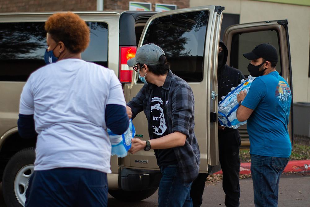 tenants distribute bottled water from a truck