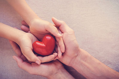adult-child-hands-holiding-red-heart-hea