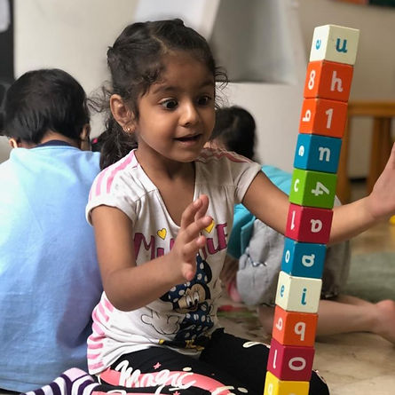 Student stacking blocks