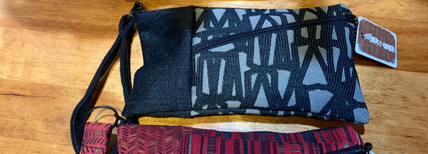 Carry on your wrist or toss in a larger bag. Front and back zip pockets. By Maruca Design, Colorado.