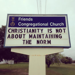 """Image: Church sign reading """"Christianity is not about maintaining the norm"""""""