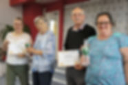 Clients present Long Service Awards to V
