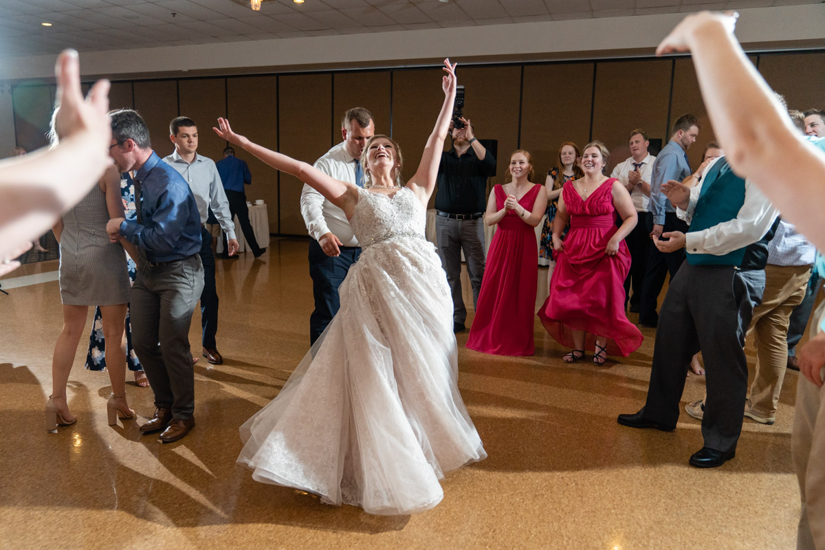 Bride in the center of the dance floor dancing happily - Indianapolis Wedding Photographer, Emma Males