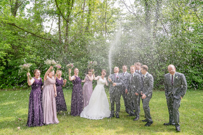bridal party with champagne sprayingceremony pictures at beautiful catholic church - Emma Males Photography