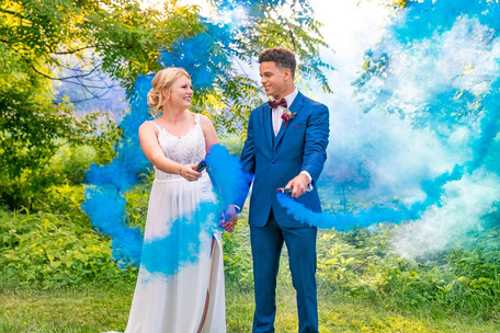Couple with blue smoke bomb at Styled Shoot by Emma Males Photography at The Vineyard Gardens in Indianapolis Indiana
