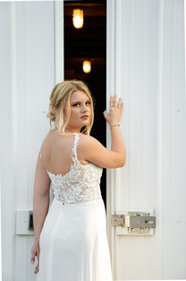 Posed shot of bride looking over shoulder at Styled Shoot by Emma Males Photography at The Vineyard Gardens in Indianapolis Indiana