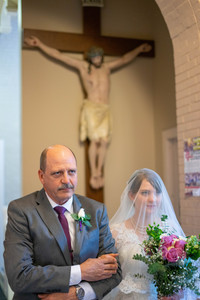 dad and veiled bride walking down aisle - Emma Males wedding photography