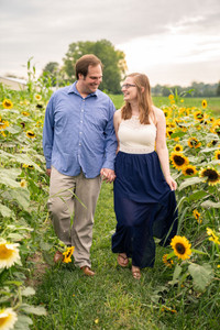 Couple holding hands in sunflower field - Indianapolis Wedding Photographer