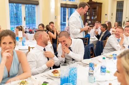 laughing at wedding reception