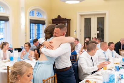 hugging maid of honor
