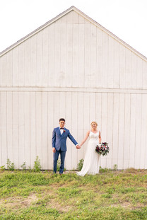 Couple in front of barn at Styled Shoot by Emma Males Photography at The Vineyard Gardens in Indianapolis Indiana