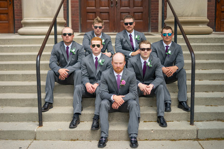 groomsmen sitting on steps in sunglasses - Emma Males Photography