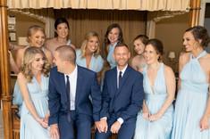 grooms talking to bridesmaids at laurel hall