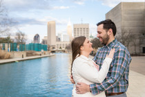 smiling couple in front of the Indianapolis sky line