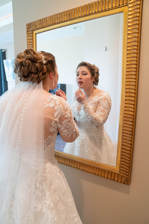 Indiana bride putting on makeup