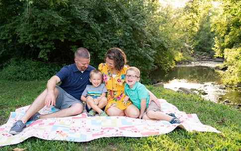 indianapolis family photo sitting by a creek