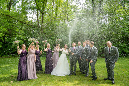 bridal party spraying champagne- Emma Males Photography