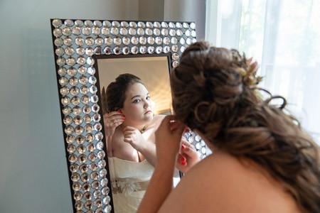 Indianapolis Wedding Photographer - bride looking in mirror
