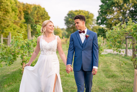 Couple walking toward camera at Styled Shoot by Emma Males Photography at The Vineyard Gardens in Indianapolis Indiana