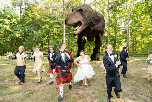 Indianapolis Wedding Photographer - unique bridal party photo of running from dino