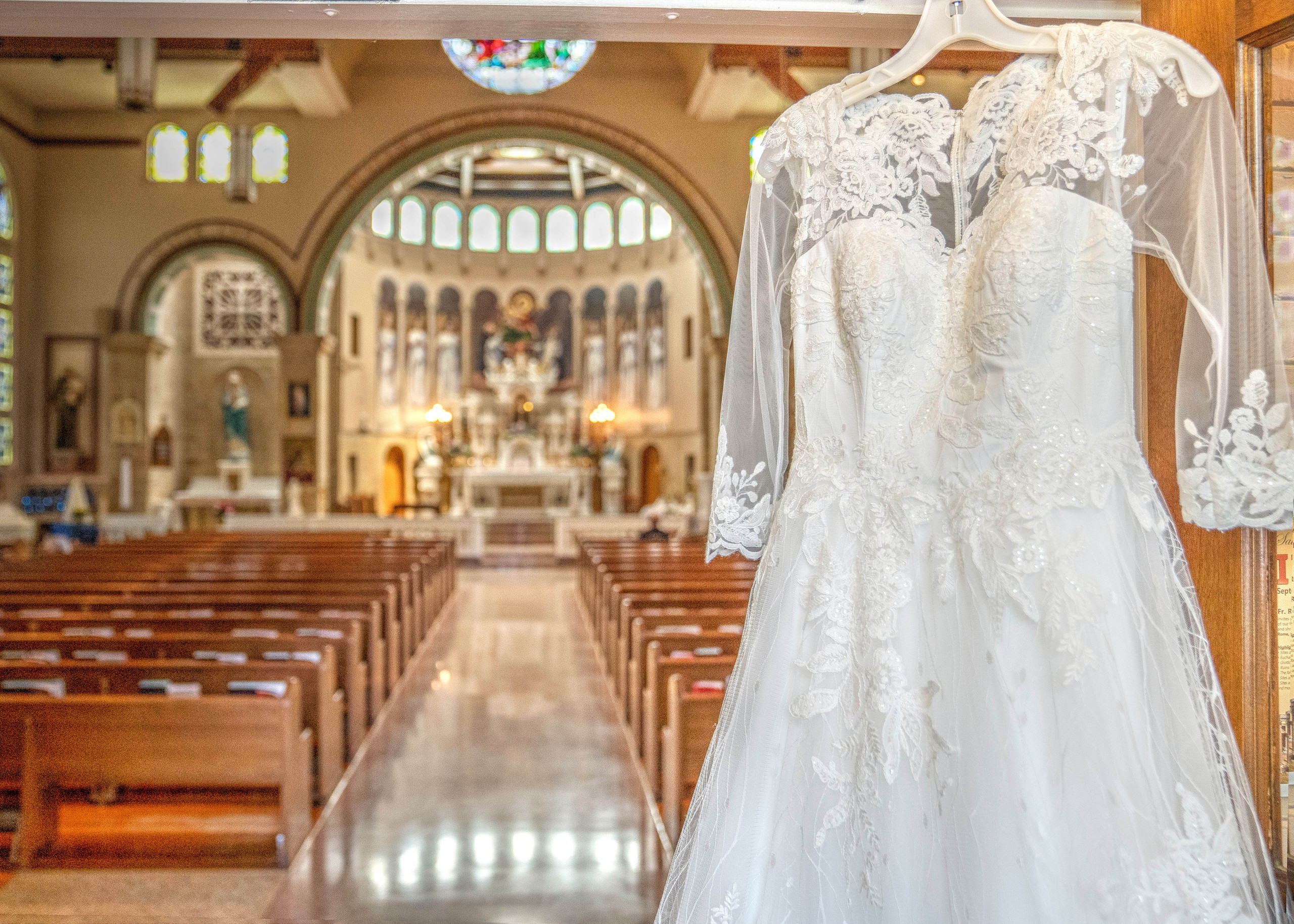 Wedding dress hanging in front of church - Indianapolis Wedding Photographer, Emma Males