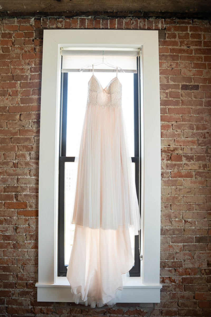 Dress hanging from window Emma Males Photography