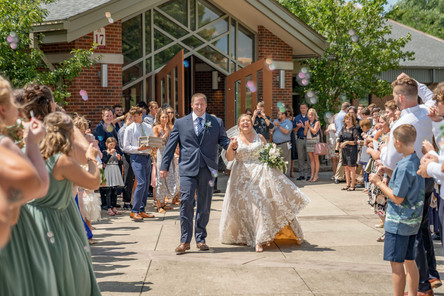 Indianapolis Wedding Photographer Emma Males - bride and groom walking out of church