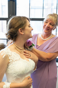 bride and mom looking at each other - Emma Males wedding photography