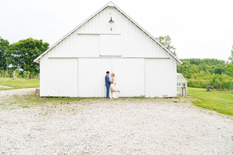 Couple in front of White Barn at Styled Shoot by Emma Males Photography at The Vineyard Gardens in Indianapolis Indiana